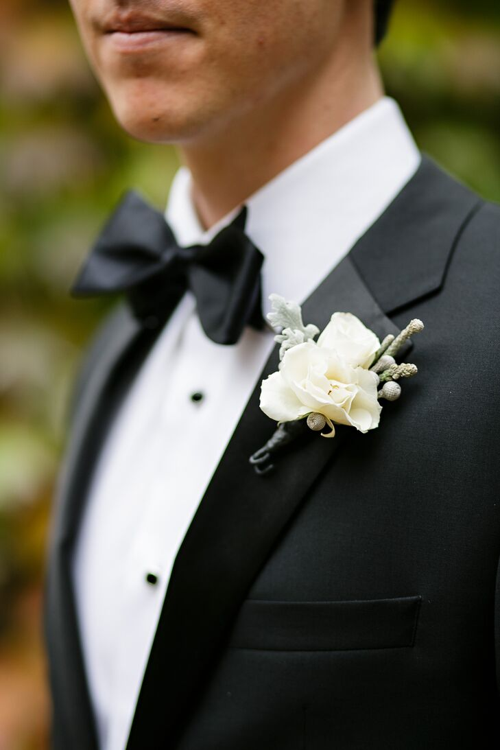 White Rose Boutonniere With Black Bow Tie