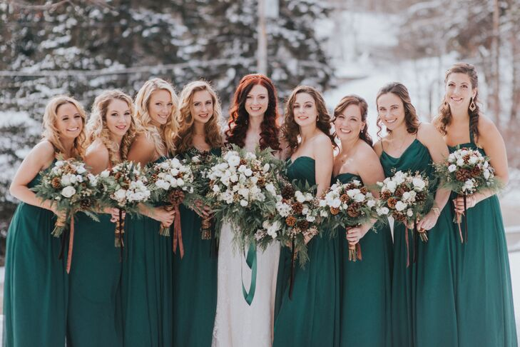 Cait's six bridesmaids wore emerald green gowns, echoing the crisp wintery theme of the day.