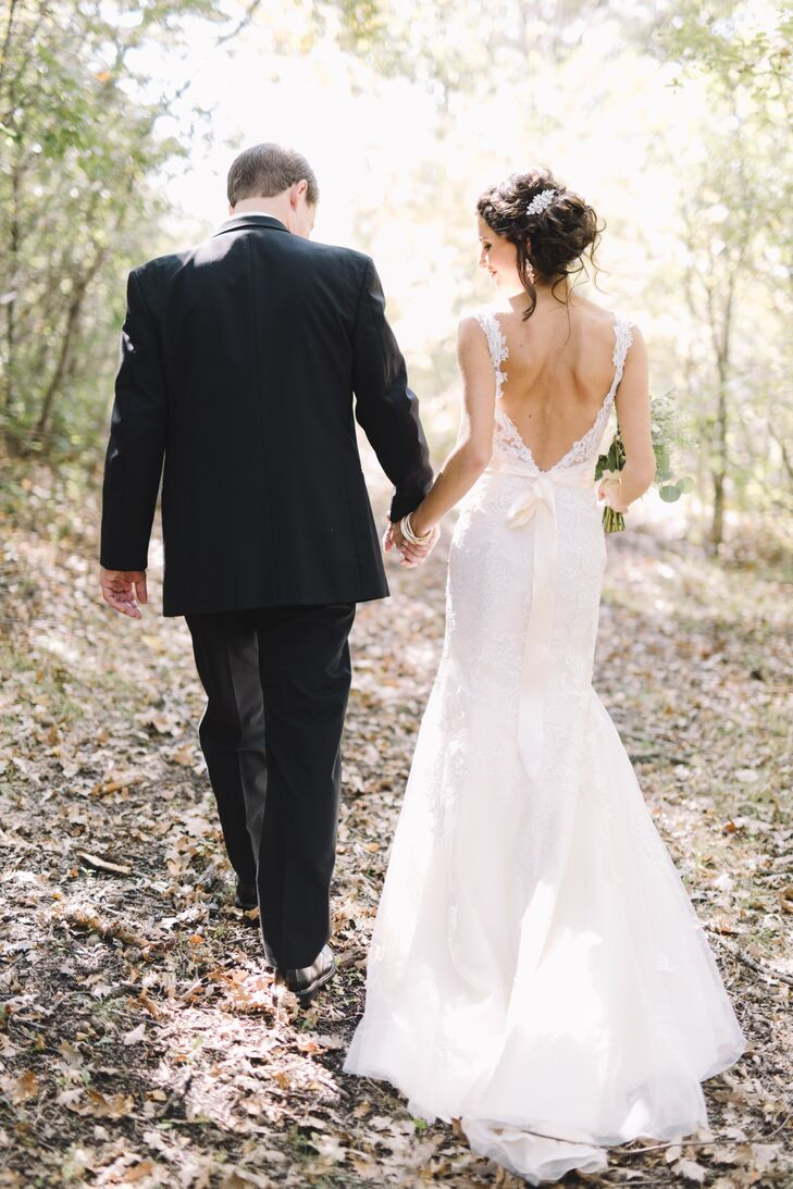 """""""My dress was the hardest thing for me to decide on—I loved too many of them,"""" Oriana says. """"I often joke with my husband that we'll need vow renewals every five years, so I can buy more dresses.""""  She chose a form-fitting Cosmobella gown from Macy's with a low, open back and lace details."""
