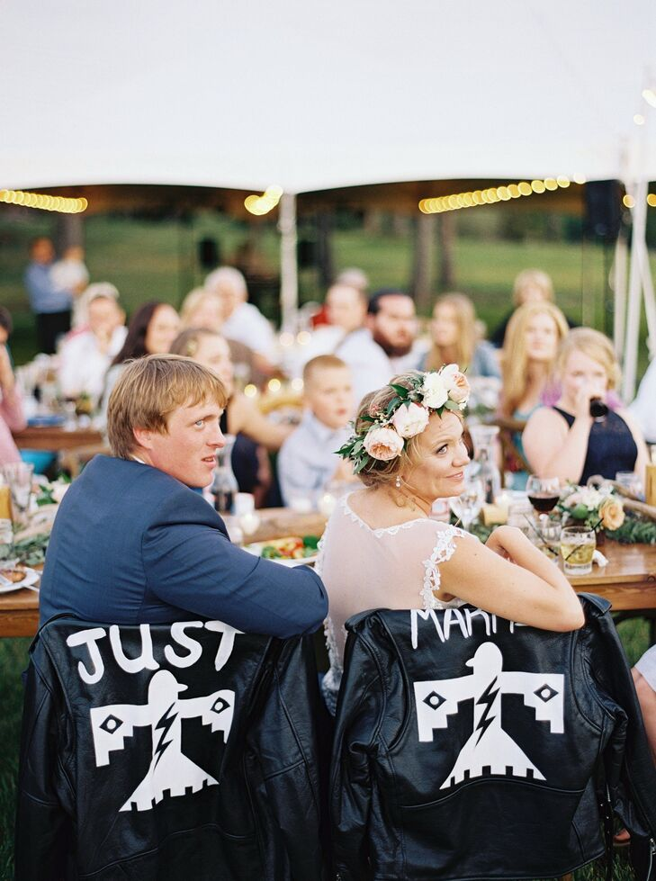 """One of our favorite details were the 'Just Married' leather jackets custom-made by one of the bride's best friends (inspiration taken from Kim and Kanye's wedding). The jackets were on the backs of our chairs at the reception and made for a perfect cover-up as the night cooled down."""
