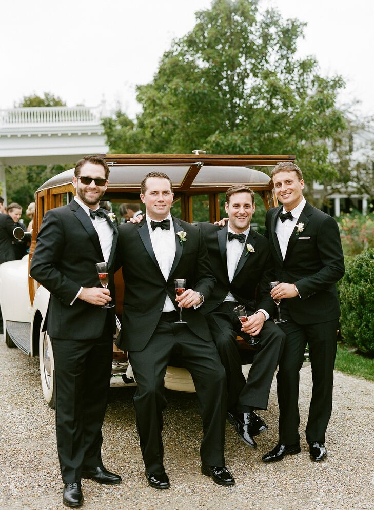 Nicholas and his groomsmen took the classic route when it came to their wedding day attire. He donned a sleek Ralph Lauren Black Label tuxedo and customized cufflinks with the nautical coordinates of St. Elizabeth's Church and each of his groomsmen wore a complementary style. To thank the guys for all of their support, Nicholas gifted each of them with black enamel and sterling cufflinks in the shape of Martha's Vineyard from C.B. Stark in Edgartown.