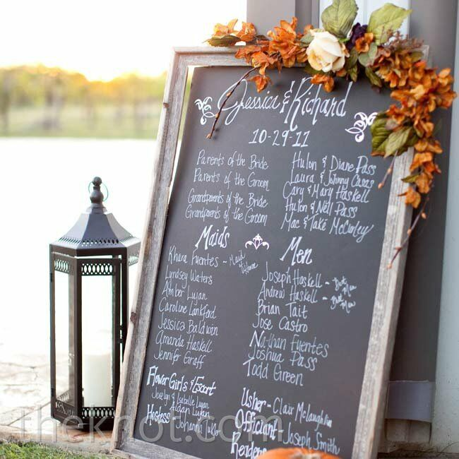 In lieu of traditional booklets, a large chalkboard decorated with silk flowers listed the ceremony details.