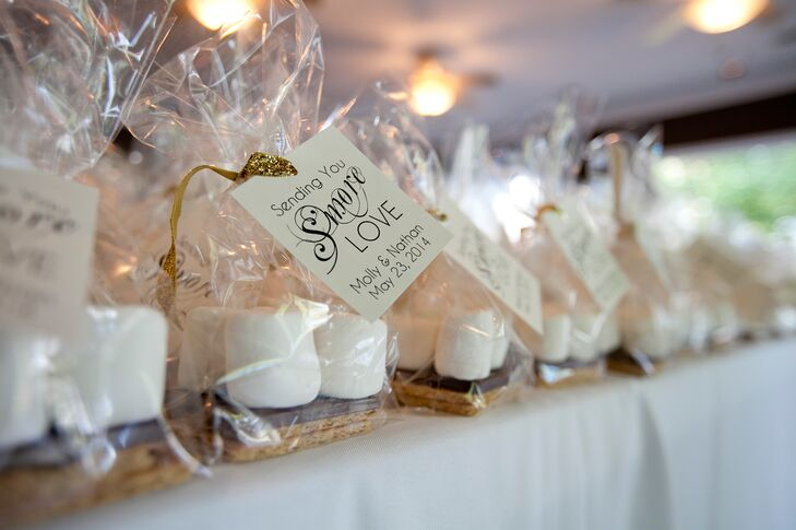 "As favors, the couple made individually wrapped s'mores kits with tags reading ""sending you s'more love."" Guests could enjoy the sweet treats during the reception at the s'mores station the couple had set up."