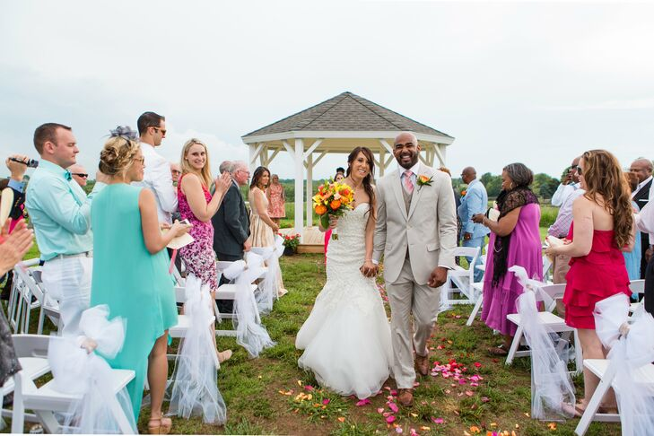 """Brandon wore a pair of cuff links from Kelsey that said """"Love of my life"""" and """"Marry me today."""" He wore a khaki suit with a pink tie, and a circus rose to match those in Kelsey's bouquet."""