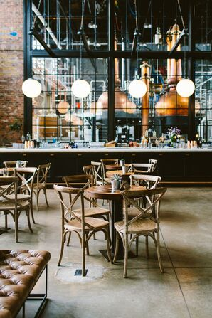 Industrial Dining Tables with Cross-back Chairs at Philadelphia Distilling