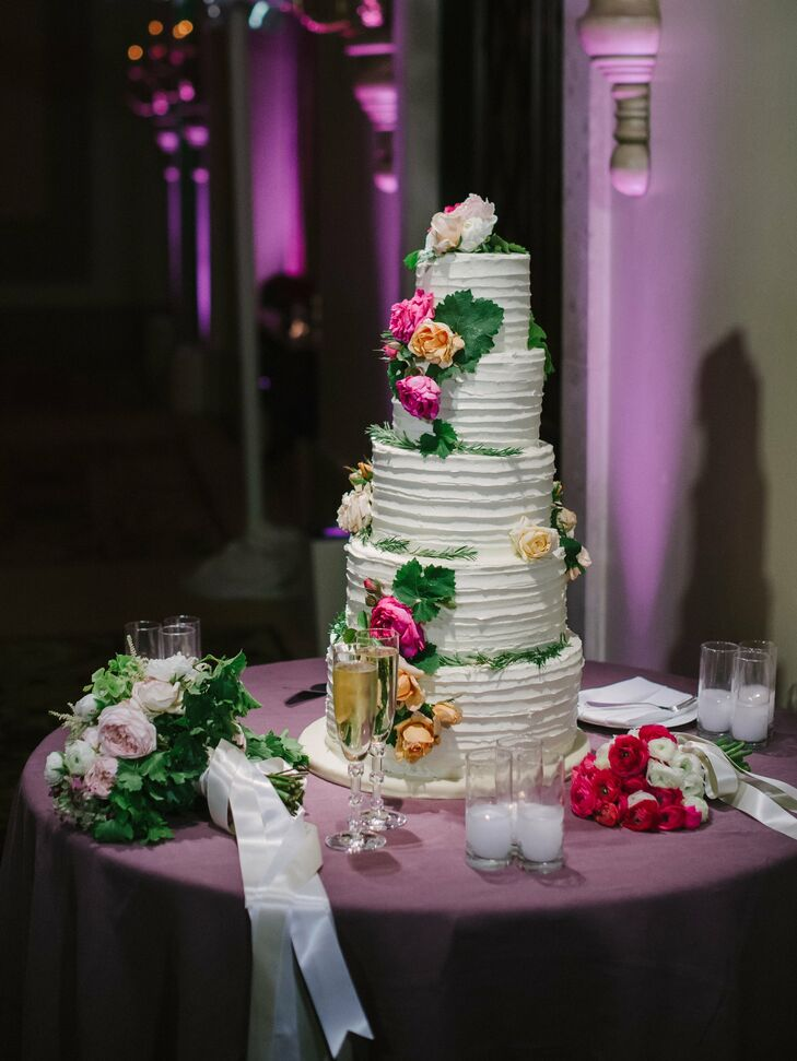 The five tier wedding cake was a combination of Katie and James's favorite flavors -- funfetti with vanilla buttercream and carrot cake with cream cheese mousse.