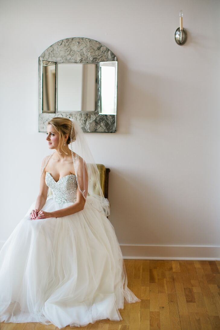 Grace wore a simple ivory wedding dress in a strapless, sweetheart style. She had a classic tulle veil that complemented the dress.