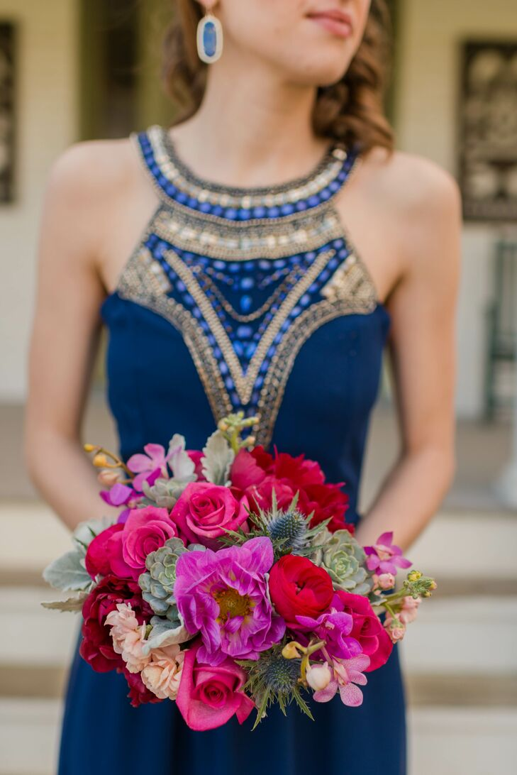 The bridesmaids carried purple peonies, blue thistles, green succulents, pink roses, red ranunculus, burgundy peonies and pink orchids in their lush, colorful bouquets. Chelsea loved how the gorgeous floral arrangements complemented the color palette and added texture to their looks.