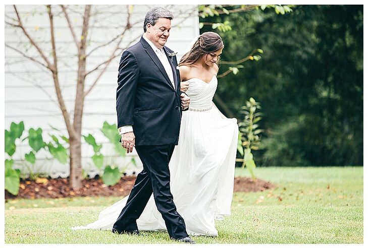 """""""After trying on about 50 dresses of the style I thought I wanted—backless lace, I went with the style my husband said he would love to see me in,"""" says Emily. """"I'm glad I did because it was a light, breezy, Grecian gown it was 105 degrees the day we got married!"""""""