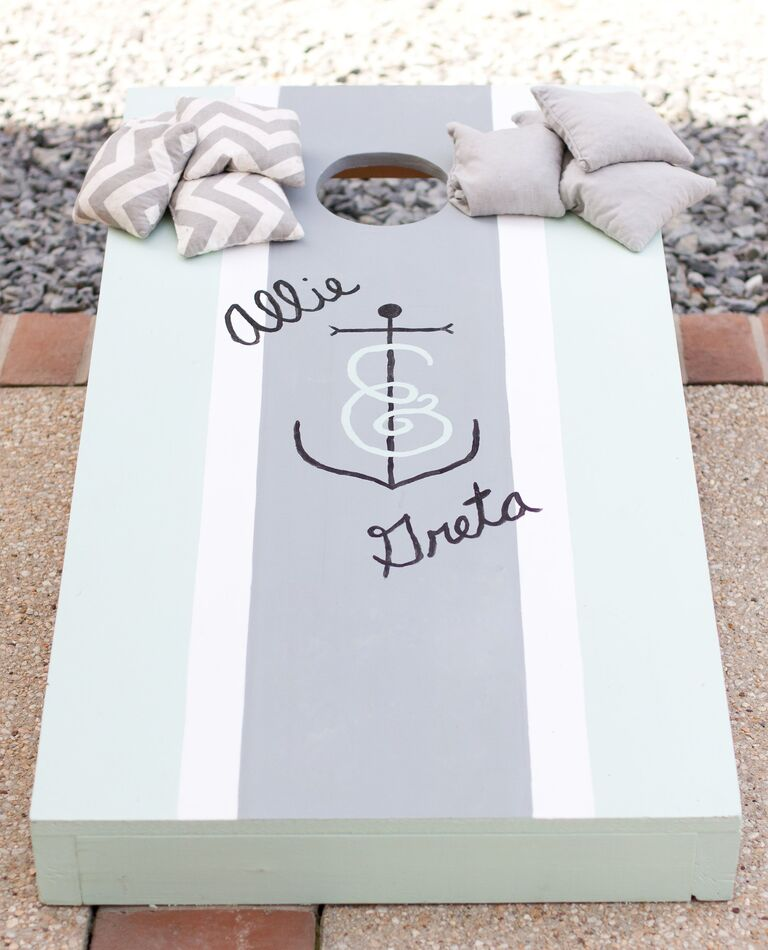 Cornhole game with seafoam and gray paint and anchor