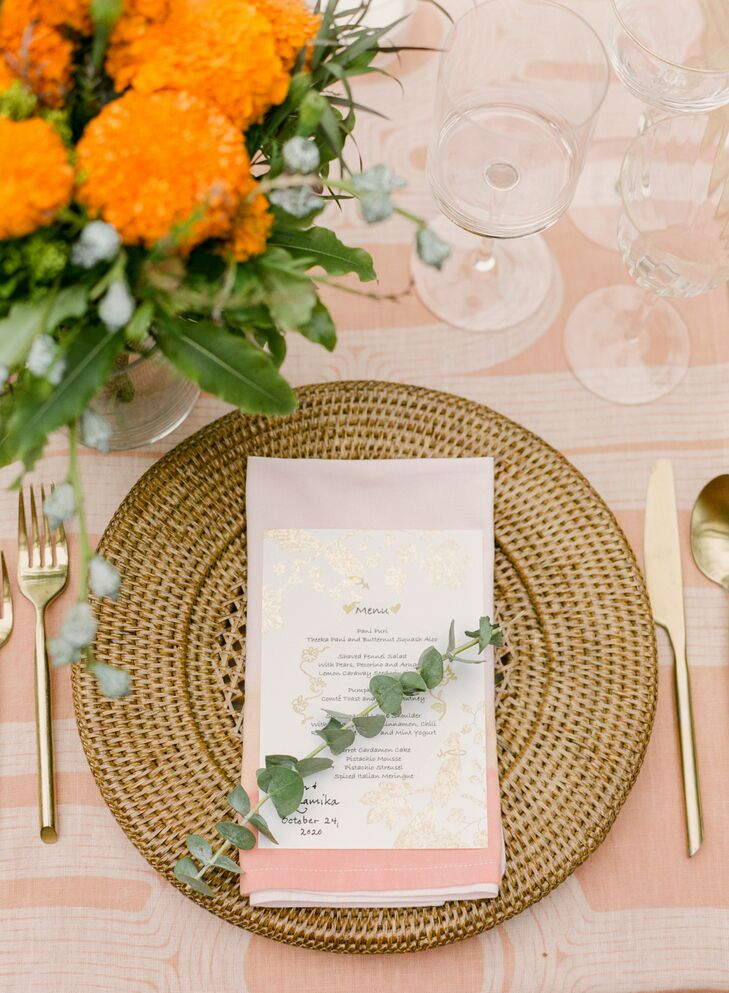 Simple Place Setting With Peach Linen and Wicker Charger