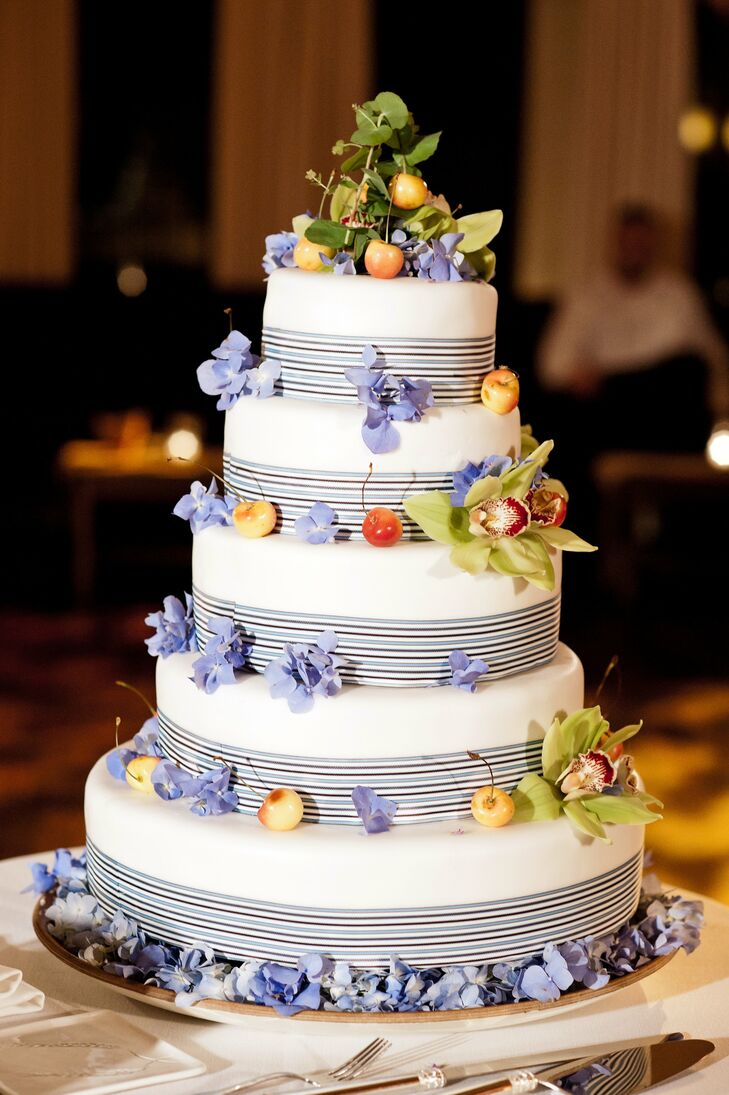 Wanting to incorporate fresh fruit into every aspect of their wedding, the couple topped their buttercream cake with fresh cherries.