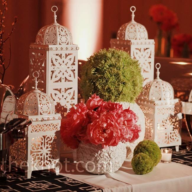 Each centerpiece was its own unique vignette made up of Jonathan Adler sculptures, sequins, beads, and floral arrangements.