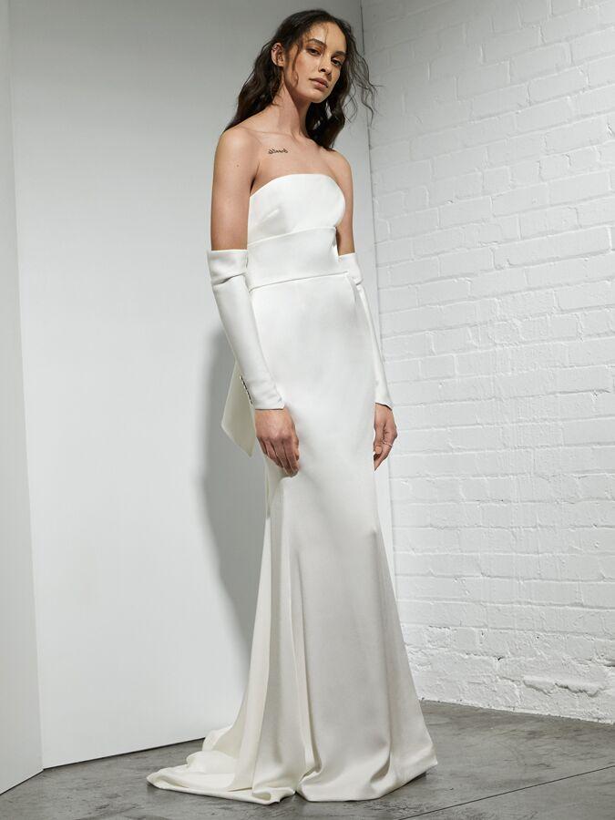 Rivini sheath wedding dress with arched neckline