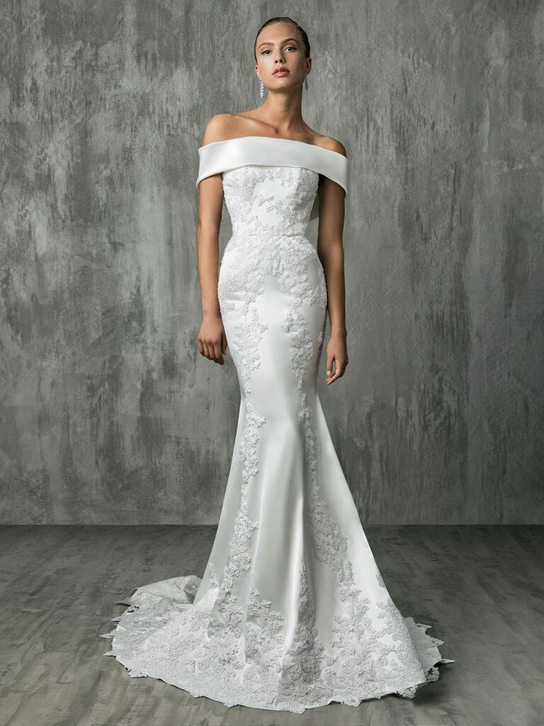 Victoria Kyriakides Fall 2018 wedding dresses with a fitted silhouette and off-the-shoulder bodice