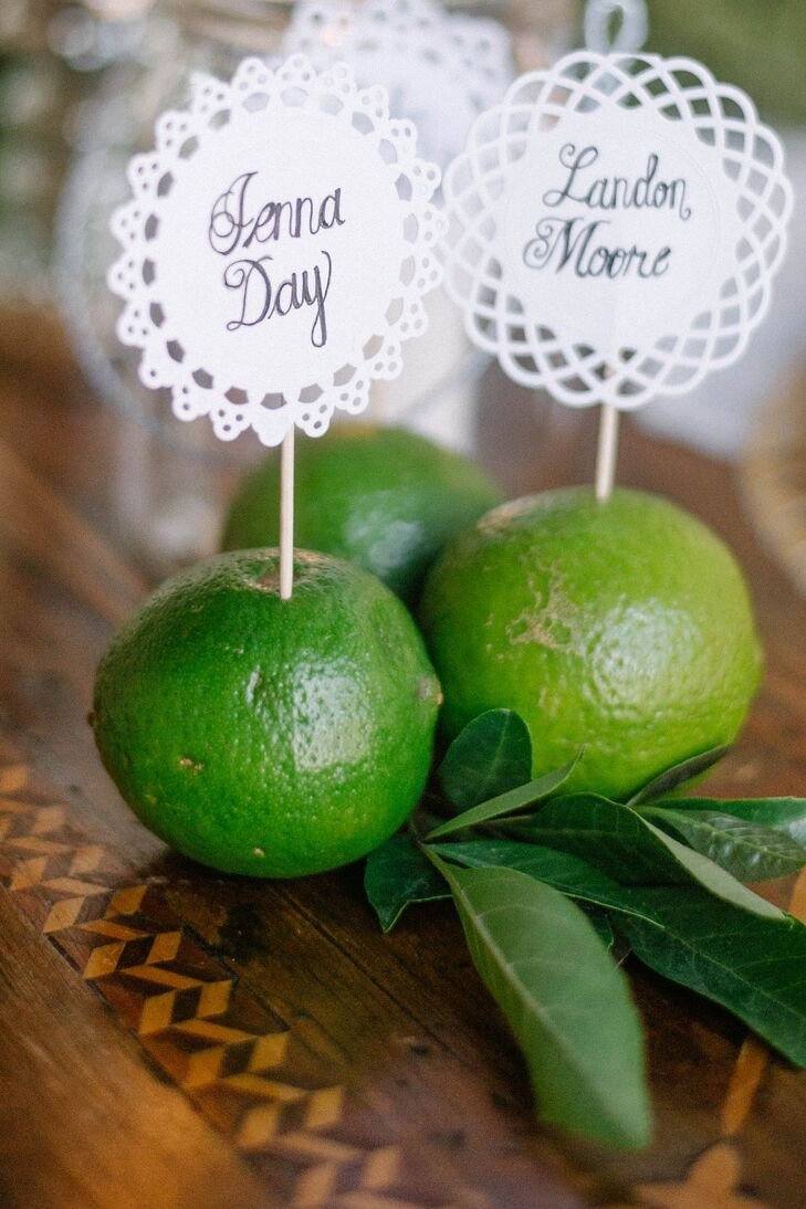 Hand calligraphed laser cut escort cards were displayed in bright green limes.