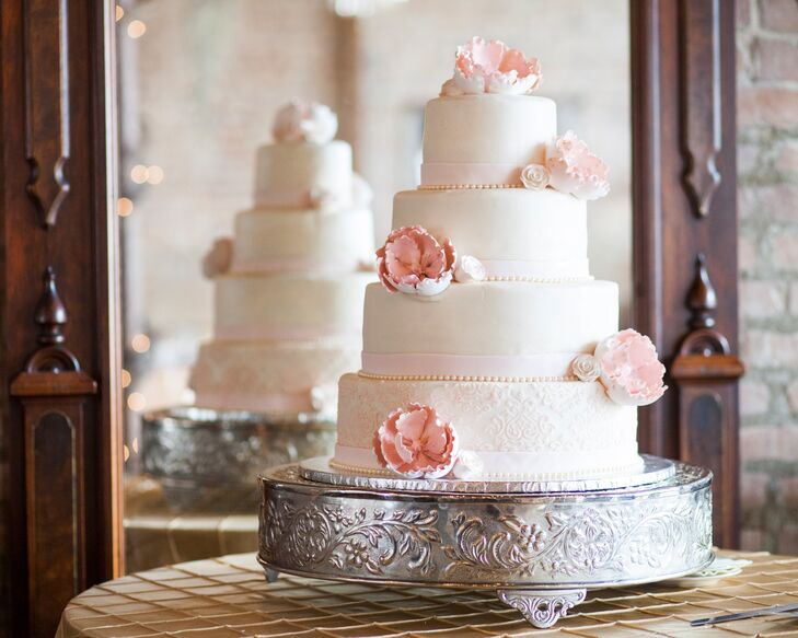 This wedding cake tasted just as good as it looked. It was an almond amaretto cake with Bavarian cream filling, and was decorated with smooth white buttercream and gorgeous pink sugar flowers.