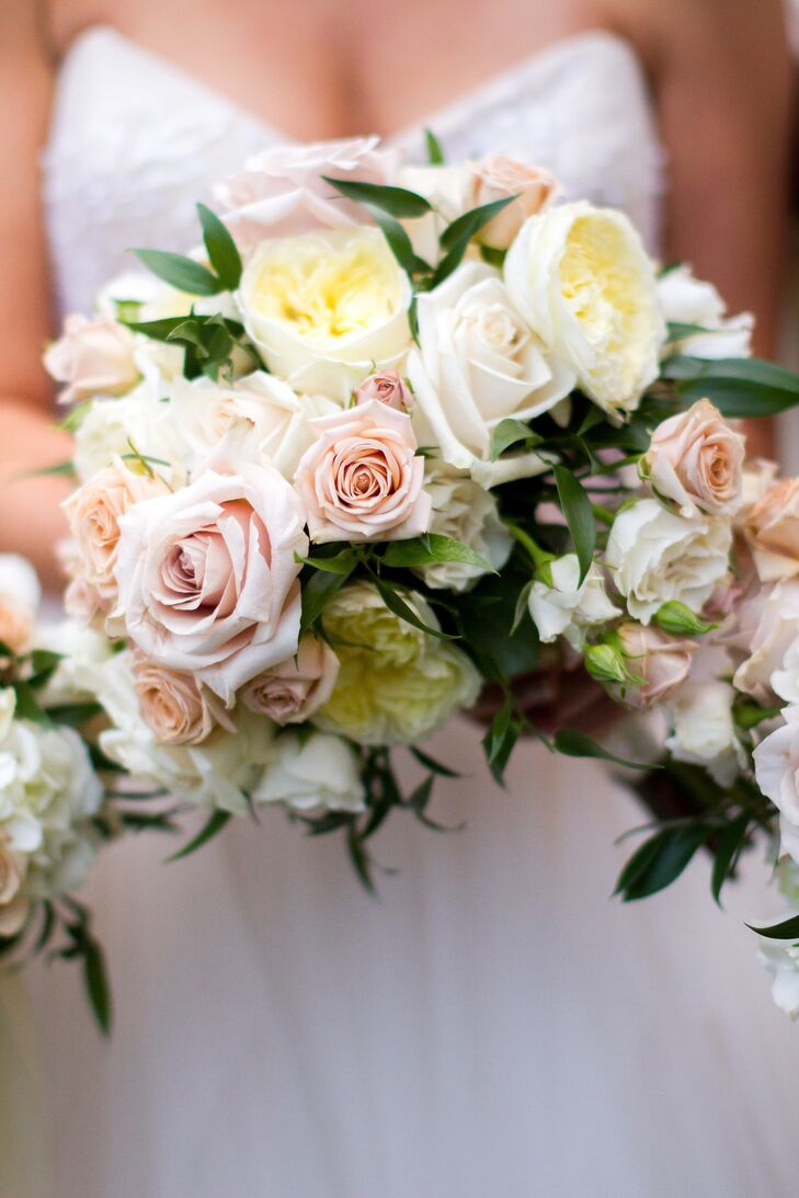 Emily carried a loose mushroom-shaped arrangement of white garden roses, creme vendela roses, ivory and champagne branch roses with antique ivory quicksand roses.