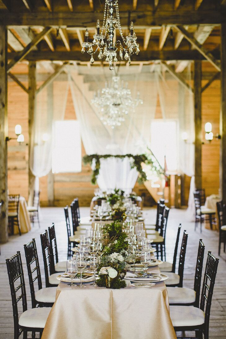 A runner of moss, herbs, succulents and fern plants accented with peach and white flowers decorated the long tables.