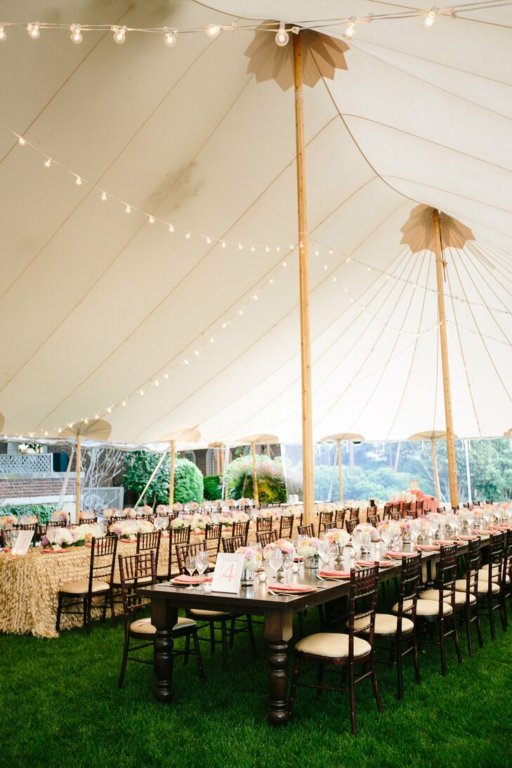 Under the tent, four long tables were set up with alternating decor, including linens and centerpieces.
