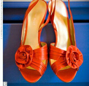 Kate complemented her look with jewel-toned elements that tied into the theme -- like her bright orange wedding shoes!