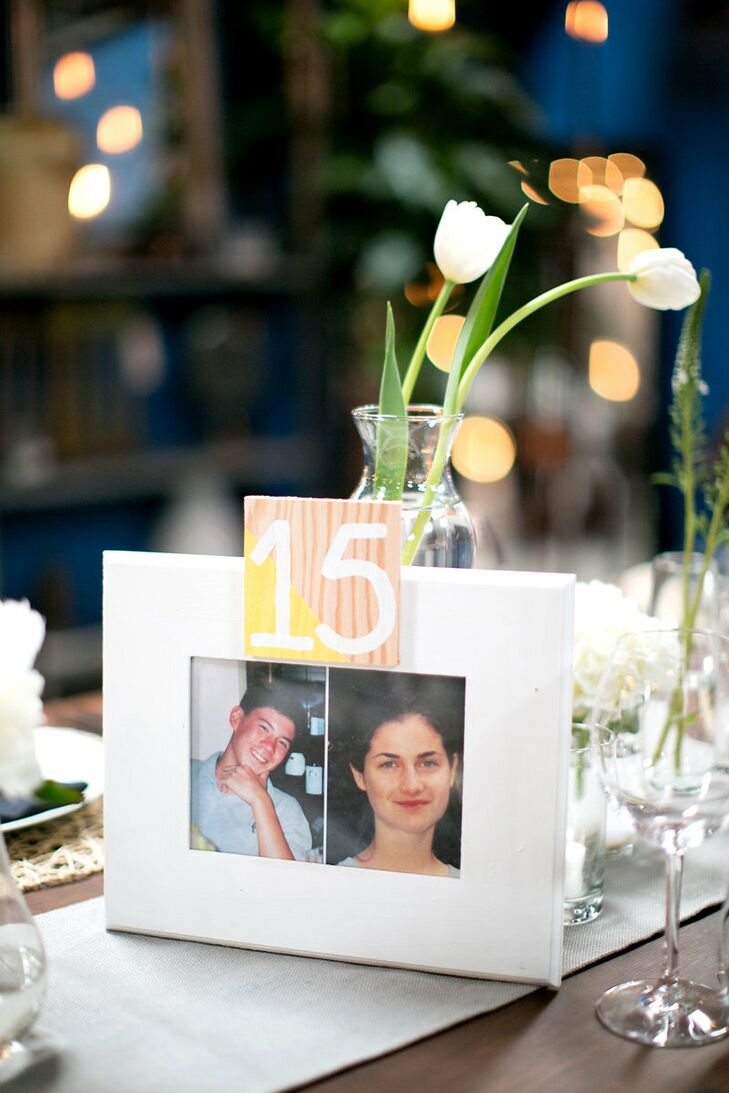 """The fun-loving couple put their personal stamp on the table numbers, filling frames with pictures of themselves at the age corresponding to the table's number. """"I felt terrible for everyone who had to sit at table 15 – 17 during our collectively awkward years,"""" says Danielle."""