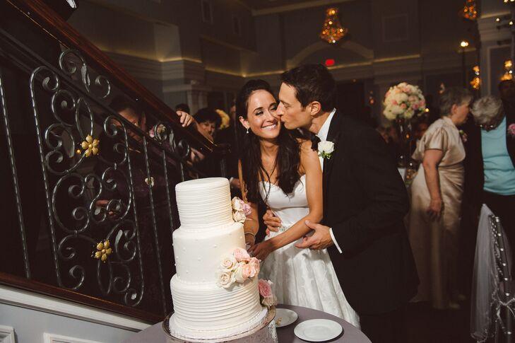 Newlyweds Cutting the White Buttercream Cake