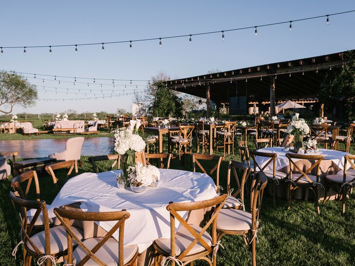 Guests were caravanned to the resort, where they were treated to dinner and drinks. Each table was lined with burlap tablecloths with a white overlay with wooden chairs to reinforce the rustic vibe. The dance floor was was surrounded with different-size tables and couches, and the reception space was accentuated with string lights.
