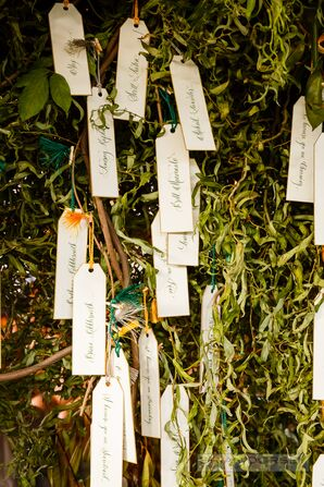 Bookmark-Inspired Escort Cards Hanging on Greenery
