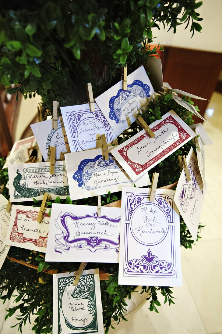 The escort cards were designed to look like art nouveau book plates, complementing the enchanted library theme.