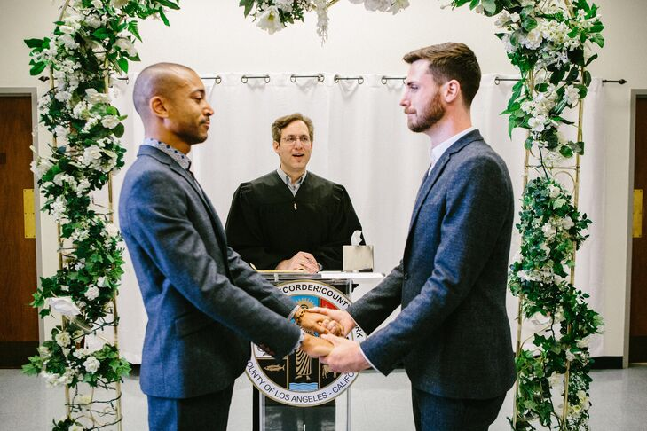 Jerrold and Drew joined their hands in matrimony underneath the green garland archway decorated with ivory flowers.