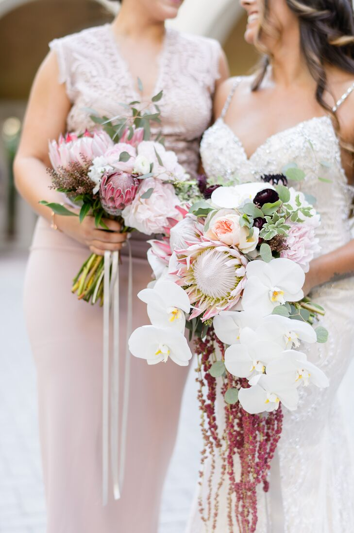 Nicole's bouquet exuded tropical flair with a bohemian twist, with a fresh mix of king proteas, orchids, amaranthus, scabiosas, garden roses, eucalyptus and ranunculus adding an element of drama to Nicole's romantic bridal look.