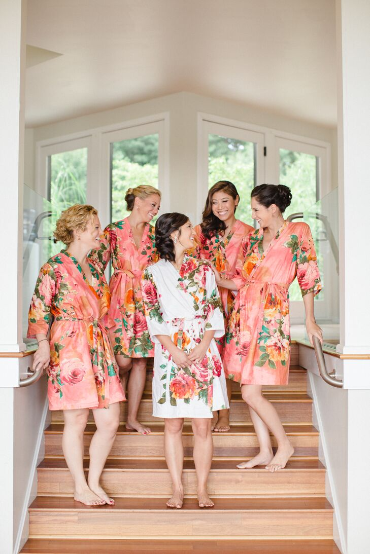 Before donning their vibrant coral J.Crew dresses for the ceremony, Hannah's bridesmaids got primped in glamorous satin robes. Playing off the garden-party theme and cheerful palette, the robes were decorated in a bright floral motif and a warm coral hue.