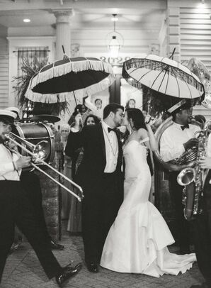 Elegant Couple with Parasols and Live Band