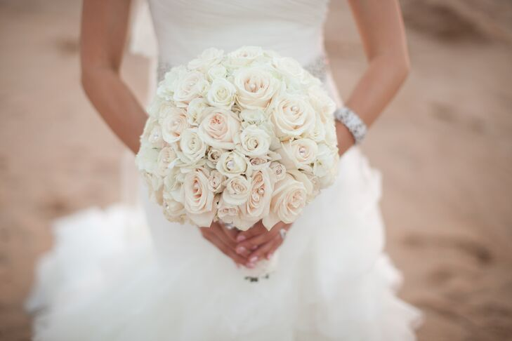 The bride carried a bouquet of subtle, soft pink and white roses as she walked down the aisle.
