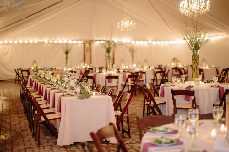 Miriam and Gordon danced the night away under large crystal chandeliers that were suspended from the ceiling of their large white tent at Merrimon-Wynne House in Raleigh, North Carolina. Whimsical decorations added to the dream-like ambience such as a seating chart made of painted mismatched frames hung on a beautiful old screen door.