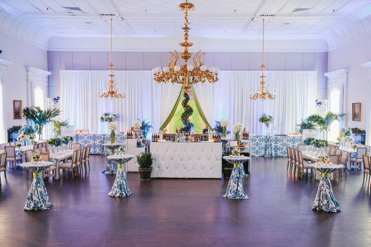 The mixed blue and green hydrangea centerpieces were designed to complement the ikat pattern linens and draping. A custom corder of green and blue hydrangeas was created to frame the fabric-covered stage.