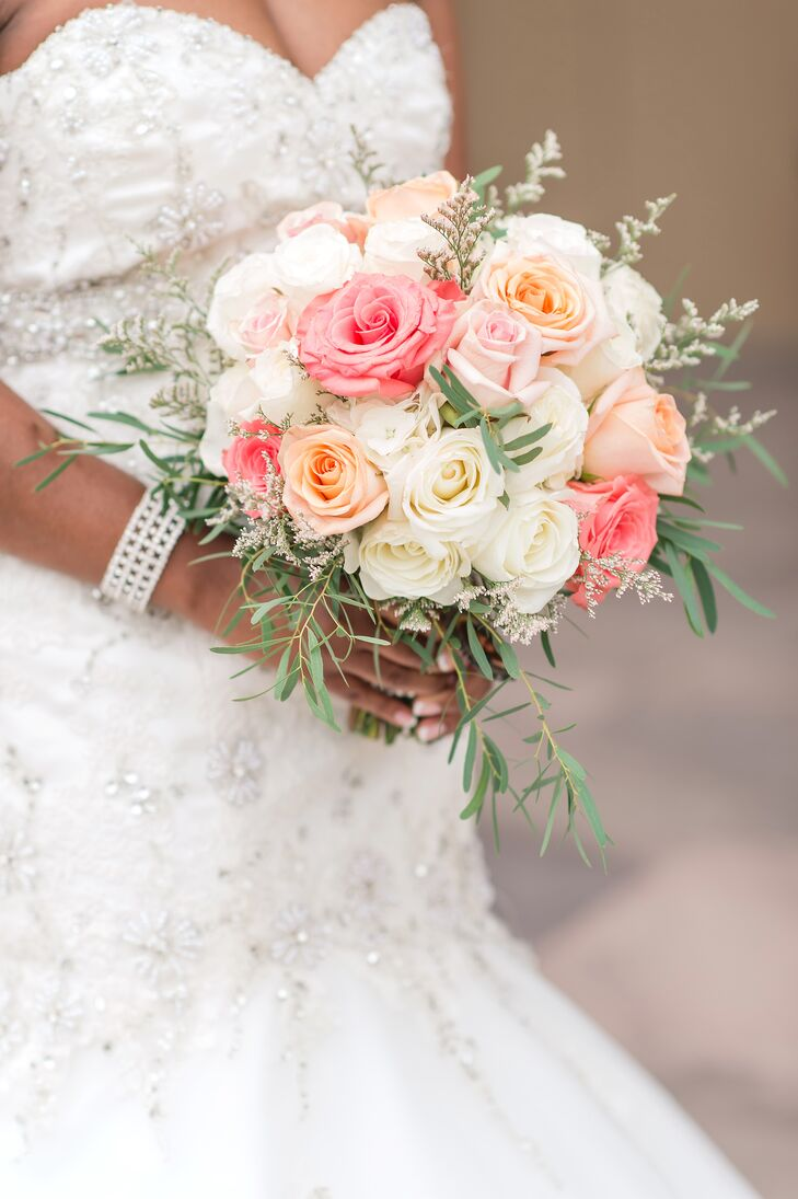 Tight Bouquet of Coral, Orange and White Roses and Eucalyptus
