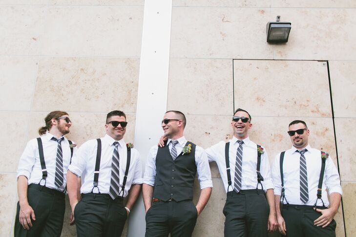 Seth stood out from his groomsmen with  a charcoal gray vest; they wore suspenders. Other than that, they all matched with gray pants, white-and-gray-striped ties and some cool shades.