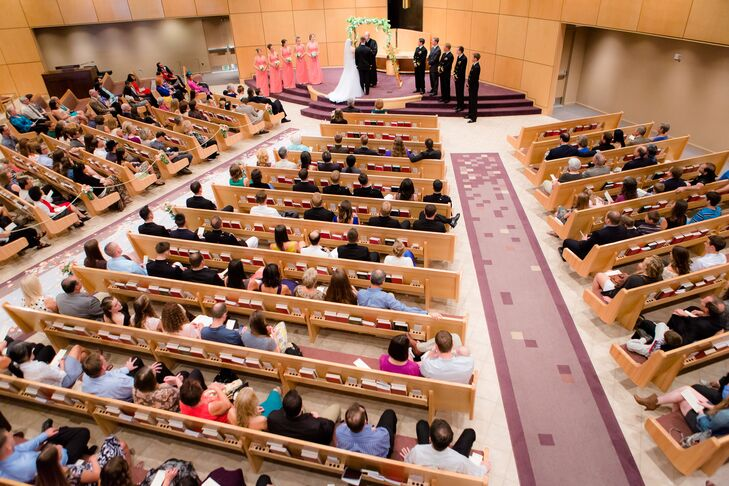"""""""Our wedding was at our church, which has a modern exposed wood architectural style,"""" says the couple. """"We loved the large sanctuary and the attached fellowship hall for our many guests. The church congregation provided tremendous support in terms of time and resources."""""""