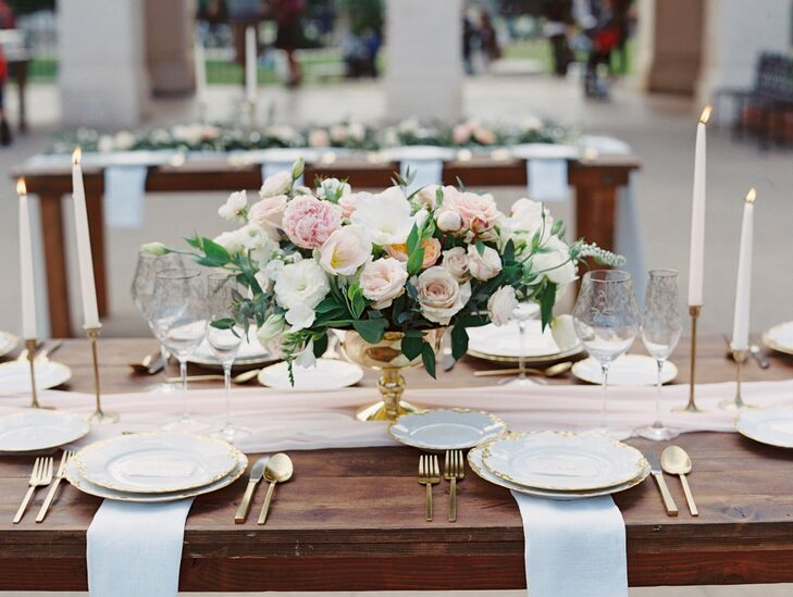 """The centerpieces were the real showstoppers, and Kasia from Plenty of Petals completely blew my mind with her floral artistry,"" Nicky says. ""Kasia mixed it up with half the tables having pastel centerpieces, and the other half with olive branch garlands with blooms placed sporadically within the garlands."""