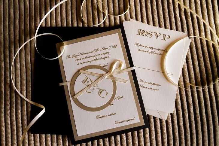 Emily and Chris had their invitations printed on classic ivory and mounted onto a thick black card stock and bound the suite together with an ivory ribbon.