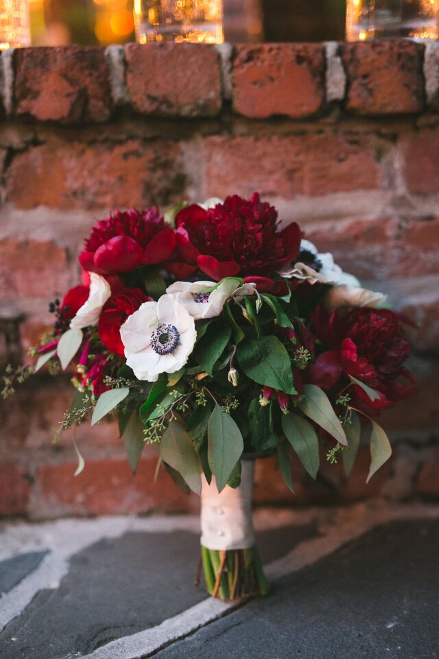 Virginia wanted blooms that were bold but minimal, and this bridal bouquet delivers with a simple pairing of deep red peonies and black-and-white anemones.