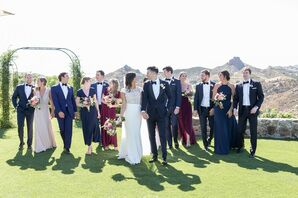 Classic, Elegant Wedding Party with Jewel-Toned Dresses and Navy Tuxedos