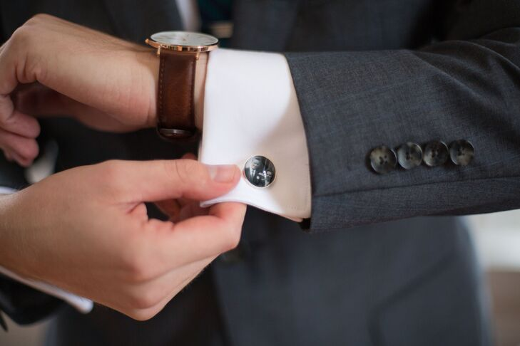 "In addition to his charcoal suit, Gordon donned sentimental, custom-made cuff links. ""A few weeks before the wedding, Miriam gave me cuff links with pictures of my two sets of grandparents on their wedding day,"" Gordon says."