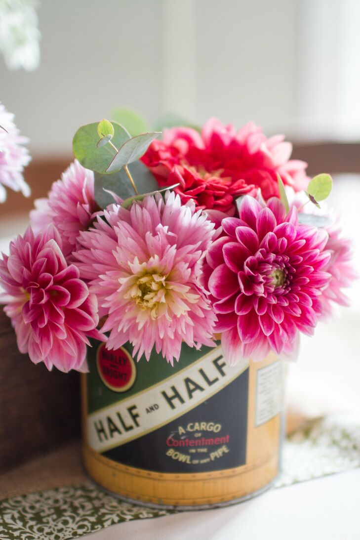 These vintage-inspired cans housed hot pink dahlias and eucalyptus leaves for a quirky centerpiece that complemented the bride's color palette.
