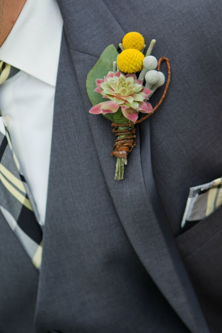 Billy balls, brunia berries and a tiny succulent made up the masculine boutonnieres.