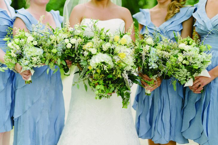 """""""We wanted an earthy feel,"""" Kate says of their floral arrangements, which mixed wildflowers with white, blue, yellow and green florals."""