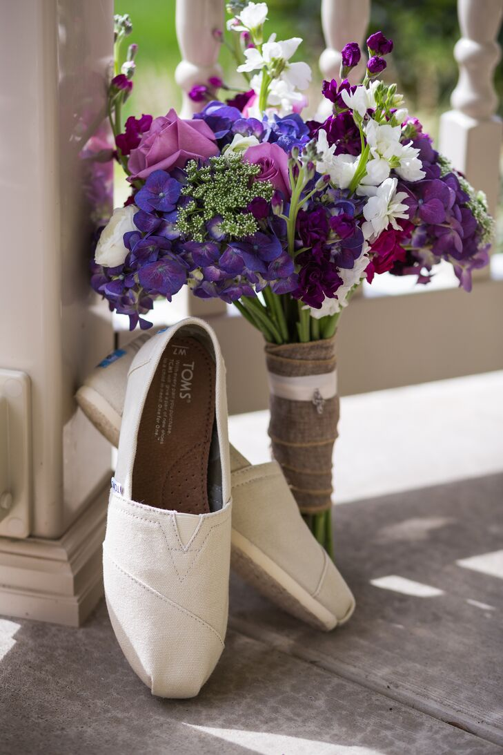 Lauren's purple bouquet was wrapped in burlap and boutonnieres were ties with twine, both incorporating rustic elements from the wedding theme.