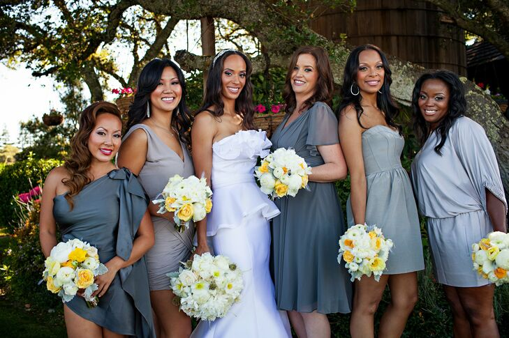 The bridesmaids wore dresses in varying shades of gray to flatter their own personal styles.